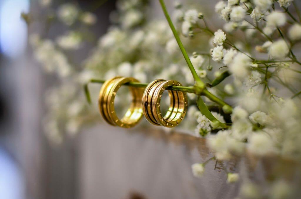 2 gold rings hanging
