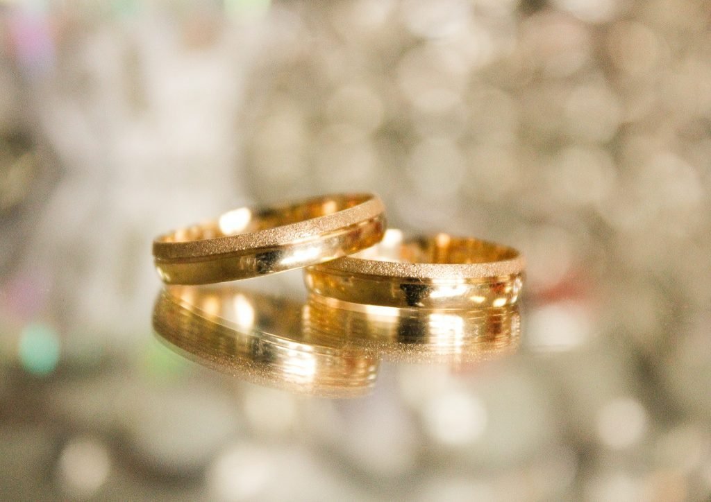 Gold rings laying on a surface